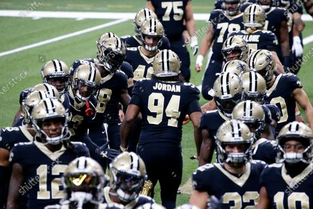 New Orleans Saints defensive end Cameron Jordan (94) warms up with his team before an NFL football game against the Carolina Panthers in New Orleans