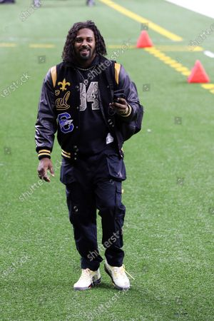 New Orleans Saints defensive end Cameron Jordan (94) arrives at the Mercedes-Benz Superdome before an NFL football game against the Carolina Panthers, in New Orleans