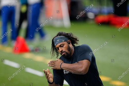 New Orleans Saints defensive end Cameron Jordan warms up before an NFL football game against the Carolina Panthers in New Orleans
