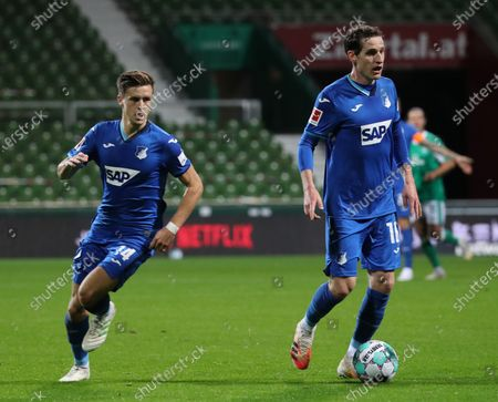 Hoffenheim players Christoph Baumgartner (L) and Sebastian Rudy (R) in action during the German Bundesliga soccer match between SV Werder Bremen and TSG Hoffenheim 1899 in Bremen, Germany, 25 October 2020.