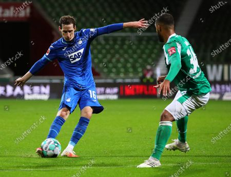 Hoffenheim's Sebastian Rudy (L) in action against Bremen's Jean-Manuel Mbom (R) during the German Bundesliga soccer match between SV Werder Bremen and TSG Hoffenheim 1899 in Bremen, Germany, 25 October 2020.
