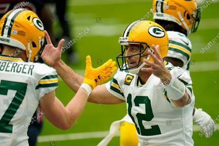 Green Bay Packers quarterback Aaron Rogers (12) celebrates after a touchdown during an NFL football game against the Houston Texans, in Houston