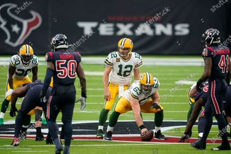 Stock Photo of Green Bay Packers quarterback Aaron Rogers (12) looks to take the snap from center Corey Linsley (63) during an NFL football game against the Houston Texans, in Houston