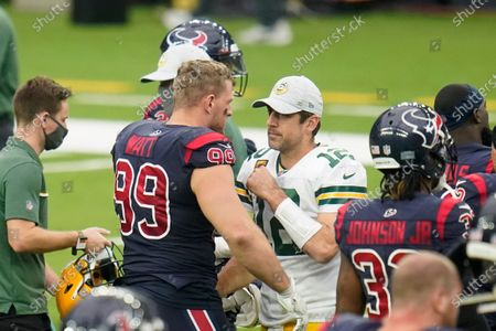Houston Texans defensive end J.J. Watt (99) and Aaron Rogers (12) meet after an NFL football game against the Green Bay Packers, in Houston