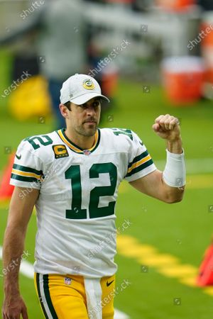 Stock Image of Green Bay Packers quarterback Aaron Rogers (12) fist pumps the crowd as he walks off the field after an NFL football game against the Houston Texans, in Houston