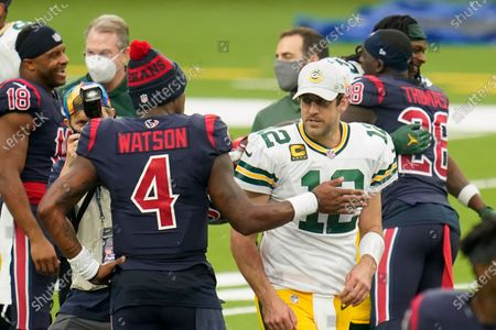 Stock Image of Houston Texans quarterback Deshaun Watson (4) and Aaron Rogers (12) meet after an NFL football game against the Green Bay Packers, in Houston