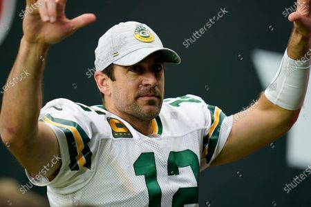 Green Bay Packers quarterback Aaron Rogers (12) fist pumps the crowd as he walks off the field after an NFL football game against the Houston Texans, in Houston