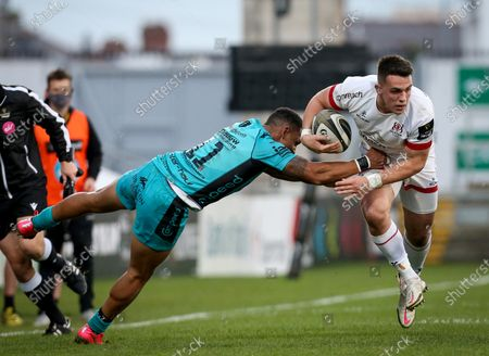 Stock Picture of Ulster vs Dragons. Ulster's James Hume in action with Ashton Hewitt of Dragons