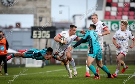 Ulster vs Dragons. Ulster's James Hume is tackled by Ashton Hewitt of Dragons