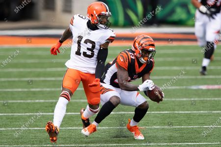 Cincinnati Bengals cornerback Darius Phillips (23) intercepts a pass intended for Cleveland Browns wide receiver Odell Beckham Jr. (13) during an NFL football game, in Cincinnati
