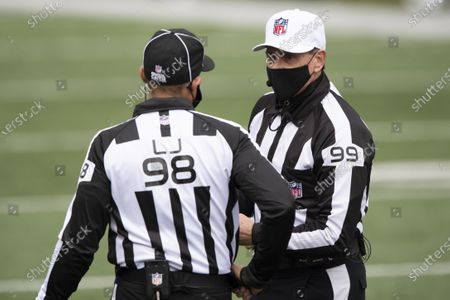 Head linesman Greg Bradley (98) and referee Tony Corrente (99) during an NFL football game against Cleveland Browns and Cincinnati Bengals, in Cincinnati