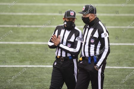 Head linesman Greg Bradley (98) and line judge Mark Perlman (9) during an NFL football game against Cleveland Browns and Cincinnati Bengals, in Cincinnati