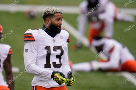 Cleveland Browns' Odell Beckham Jr. (13) stretches before an NFL football game against the Cincinnati Bengals, in Cincinnati