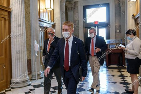 Stock Image of From left, Sen. Roger Wicker, R-Miss., Sen. James Lankford, R-Okla., and Sen. Richard Burr, R-N.C., arrive for votes during a rare weekend session to advance the confirmation of Judge Amy Coney Barrett to the Supreme Court, at the Capitol in Washington