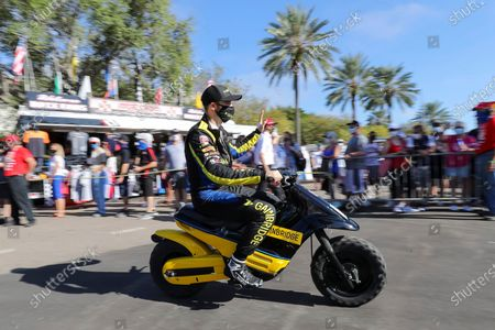 James Hinchcliffe rides out to the track to warm up for an IndyCar auto race, in St. Petersburg, Fla
