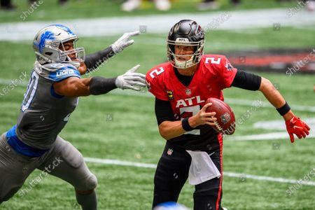 Atlanta Falcons quarterback Matt Ryan (2) evades Detroit Lions defensive end Trey Flowers (90) during the first half of an NFL football game, in Atlanta