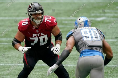 Atlanta Falcons offensive tackle Jake Matthews (70) works against Detroit Lions defensive end Trey Flowers (90) during the first half of an NFL football game, in Atlanta