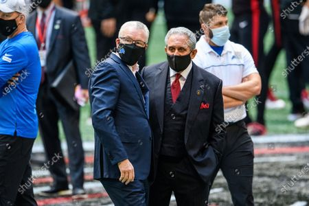 Atlanta Falcons Owner Arthur Blank talks with Detroit Lions President and CEO Ron Wood before an NFL football game, in Atlanta