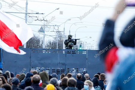 Belarusian riot police stand guard on top of a police barricade blocking a street during an opposition rally to protest the official presidential election results in Minsk, Belarus, . The demonstrations were triggered by official results giving President Alexander Lukashenko 80% of the vote in the Aug. 9 election that the opposition insists was rigged. Lukashenko, who has ruled Belarus with an iron fist since 1994, has accused the United States and its allies of fomenting unrest in the ex-Soviet countrystockképe