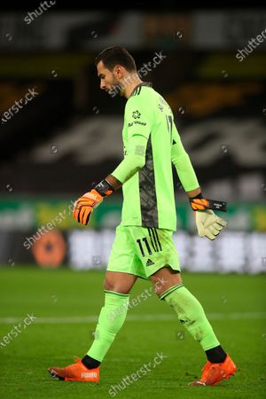Wolverhampton Wanderers' goalkeeper Rui Patricio walks in dejection end of the English Premier League soccer match between Wolves and Newcastle United at Molineux Stadium in Wolverhampton, England
