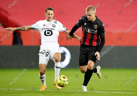 Stock Image of Kasper Dolberg (R) of Nice and Domagoj Bradaric (L) of Lille in action during the French Ligue 1 soccer match between OGC Nice and Lille OSC in Nice, France, 25 October 2020.