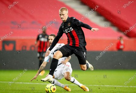 Stock Picture of Kasper Dolberg (R) of Nice and Domagoj Bradaric (L) of Lille in action during the French Ligue 1 soccer match between OGC Nice and Lille OSC in Nice, France, 25 October 2020.