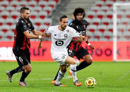 Yusuf Yazici (C) of Lille in action against Nice players Morgan Schneiderlin (L) and Dante (R) during the French Ligue 1 soccer match between OGC Nice and Lille OSC in Nice, France, 25 October 2020.