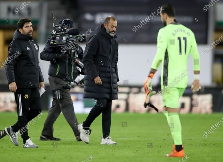 Wolverhampton manager Nuno Espirito Santo (C) and goalkeeper Rui Patricio (R) after the English Premier League match between Wolverhampton Wanderers and Newcastle United in Wolverhampton, Britain, 25 October 2020.