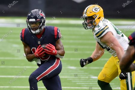 Houston Texans wide receiver Randall Cobb, left, catches a pass as Green Bay Packers linebacker Ty Summers defends during the second half of an NFL football game, in Houston