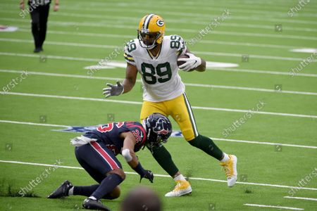 Green Bay Packers tight end Marcedes Lewis (89) runs with the ball as Houston Texans cornerback Vernon Hargreaves III (26) defends during the first half of an NFL football game, in Houston