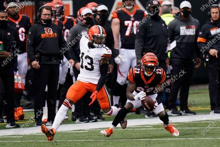 Cincinnati Bengals' Darius Phillips (23) intercepts a pass intended for Cleveland Browns' Odell Beckham Jr. (13) during the first half of an NFL football game, in Cincinnati
