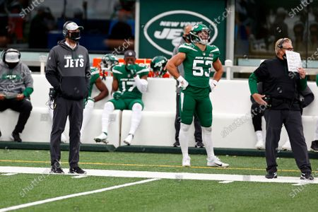 New York Jets head coach Adam Gase and defensive Coordinator Gregg Williams look on during an NFL football game against the Buffalo Bills, in East Rutherford, N.J