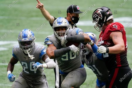 Detroit Lions defensive end Trey Flowers (90) celebrates during the second half of an NFL football game against the Atlanta Falcons, in Atlanta