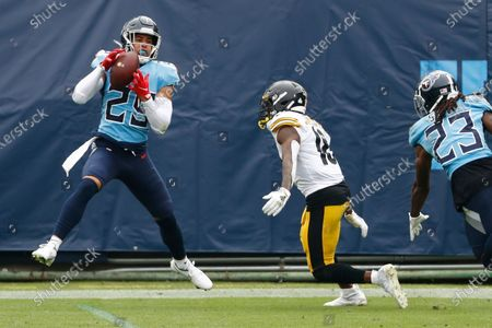 Tennessee Titans defensive back Dane Cruikshank (29) intercepts a pass intended for Pittsburgh Steelers wide receiver Diontae Johnson (18) in the first half of an NFL football game, in Nashville, Tenn