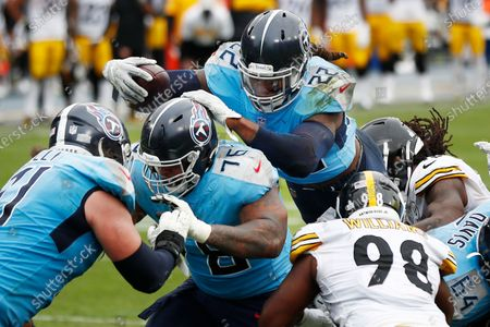 Tennessee Titans running back Derrick Henry (22) follows the blocking of offensive guard Rodger Saffold (76) as Henry scores a touchdown against the Pittsburgh Steelers in the second half of an NFL football game, in Nashville, Tenn