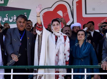 Maryam Nawaz, center, leader of the Pakistan Democratic Movement, waves to supporters upon her arrival to attend an anti government rally in Quetta, Pakistan, . The top leaders of an alliance of Pakistan's major opposition parties have held rally in the southwestern Pakistani town as part of a campaign to oust the government of Prime Minister Imran Khan over his alleged failure in handling the country's economic crisis