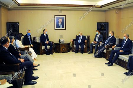 Syrian Foreign Minister Walid al-Moallem meets with visiting UN special envoy for Syria Geir Pedersen in Damascus, Syria, Oct. 25, 2020. The visiting UN special envoy for Syria Geir Pedersen on Sunday said he hopes that a common ground could be reached to help push forward the Syrian political process.