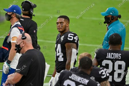 Las Vegas Raiders middle linebacker Raekwon McMillan (54) stands on the sidelines during the first half of an NFL football game against the Tampa Bay Buccaneers, in Las Vegas