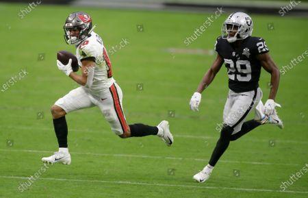 Tampa Bay Buccaneers wide receiver Scott Miller (10) runs against Las Vegas Raiders free safety Lamarcus Joyner (29) during the second half of an NFL football game, in Las Vegas