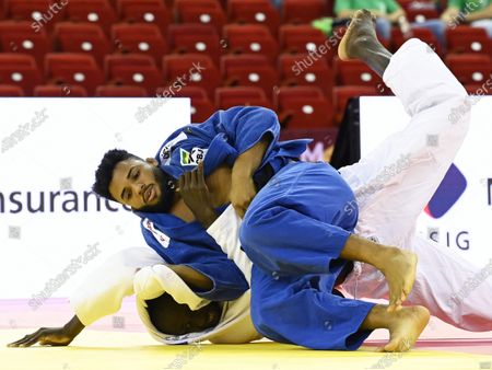 Marcelo Gomes (blue) of Brazil in action against Kwadjo Anani (white) of Ghana during their men's -90kg category bout of the Judo Grand Slam at Papp Laszlo Budapest Sports Arena in Budapest, Hungary, 25 October 2020.