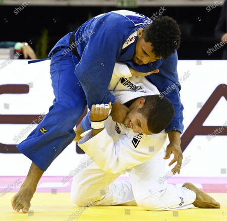 Stock Image of Marcelo Gomes (blue) of Brazil in action against Krisztian Toth (white) of Hungary during their men's -90kg category bout of the Judo Grand Slam at Papp Laszlo Budapest Sports Arena in Budapest, Hungary, 25 October 2020.