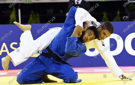 Stock Photo of Marcelo Gomes (blue) of Brazil in action against Krisztian Toth (white) of Hungary during their men's -90kg category bout of the Judo Grand Slam at Papp Laszlo Budapest Sports Arena in Budapest, Hungary, 25 October 2020.