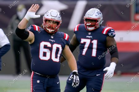 New England Patriots center David Andrews, left, and offensive lineman Mike Onwenu, right, warm up before an NFL football game against the San Francisco 49ers, in Foxborough, Mass