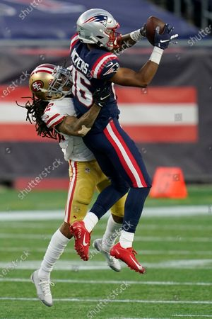 New England Patriots wide receiver Jakobi Meyers, right, catches a pass as San Francisco 49ers cornerback Jason Verrett, left, defends in the first half of an NFL football game, in Foxborough, Mass