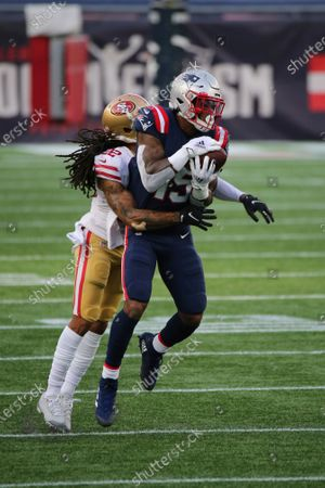 New England Patriots wide receiver N'Keal Harry (15) makes a reception as San Francisco 49ers cornerback Jason Verrett (22) defends during the first half of an NFL football game, in Foxborough, Mass
