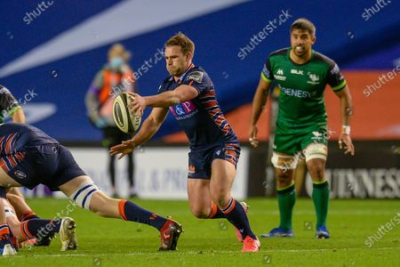 Nic Groom (#9) of Edinburgh Rugby looks to kick clear during the Guinness Pro 14 match between Edinburgh Rugby and Connacht Rugby at BT Murrayfield, Edinburgh