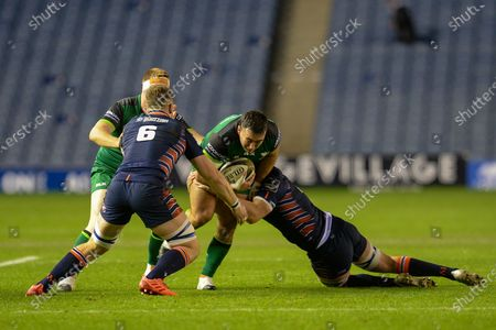 Denis Buckley (#1) of Connacht Rugby is tackled by Lewis Carmichael (#4) of Edinburgh Rugby during the Guinness Pro 14 match between Edinburgh Rugby and Connacht Rugby at BT Murrayfield, Edinburgh