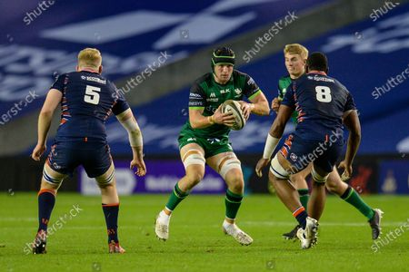 Eogan Masterson (#4) of Connacht Rugby runs at Andrew Davidson (#5) and Mesu Kunavula (#8) of Edinburgh Rugby during the Guinness Pro 14 match between Edinburgh Rugby and Connacht Rugby at BT Murrayfield, Edinburgh