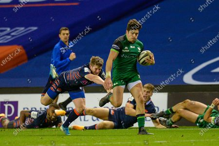 TRY Alex Wooton (#11) of Connacht Rugby evades the clutches of James Johnstone (#13) of Edinburgh Rugby to score a try during the Guinness Pro 14 match between Edinburgh Rugby and Connacht Rugby at BT Murrayfield, Edinburgh