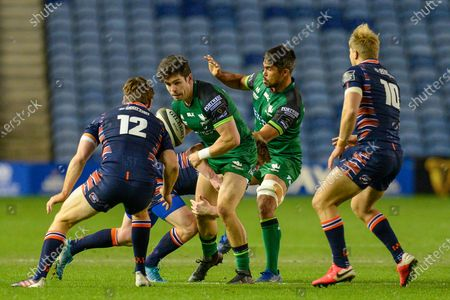 Alex Wooton (#11) of Connacht Rugby runs at Chris Dean (#12) of Edinburgh Rugby during the Guinness Pro 14 match between Edinburgh Rugby and Connacht Rugby at BT Murrayfield, Edinburgh